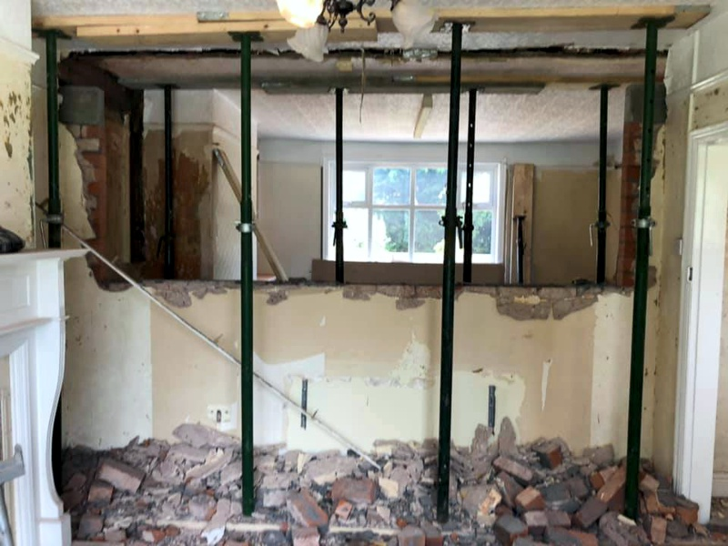 Knock-through internal wall creating space